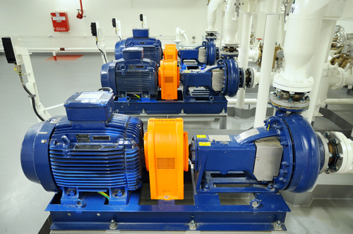 three blue electric motors featured in a factory